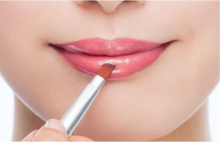 For plump-looking lips, add some lip gloss to the center of your lips