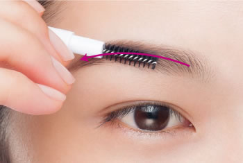 Shade along the flow of the hair using an eyebrow brush