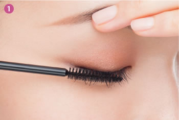 ❶Gently lift the eyelid and apply starting at the roots of the top side of the lashes, rolling the brush in an outward direction, to firmly apply.